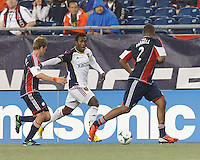 Real Salt Lake substitute defender Abdoulie (Kenny) Mansally (29) dribbles down the wing and fends off New England Revolution defender.