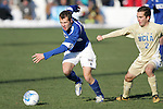 3 December 2006: UCSB's Bryan Byrne (left) dribbles away from UCLA's Jason Leopoldo (2). California-Santa Barbara defeated California-Los Angeles 2-1 at Robert R. Hermann Stadium in St. Louis, Missouri in the NCAA men's college soccer tournament final game to win the 2006 NCAA Championship.