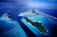 """Aerial of Palmyra Atoll showing military canal built during World War II. The largest purchase to date for the Nature Conservancy is the Palmyra an atoll situated about 300 miles north of the equator.  Palmyra has five times as many coral species as the Florida Keys and three times as many as Hawaii.  It is home to the world's largest invertebrate, the rare coconut crab, and a population of red-footed booby birds second only to that of the Galapagos.  It is the last marine wilderness area left in the U.S. tropics and is home to the last remaining stands of Pisonia grandis beach forest in the world.  Palmyra was a US Navy supply base in World War II, the site of a proposed nuclear waste dump, an unsuccessful coconut plantation and of various development schemes.  Palmyra is most famous for the 1974 slaying  of a married couple which became the subject of the best-selling book """"And the Sea Will Tell,"""" by Vincent Bugliosi."""