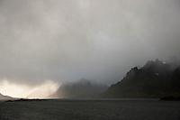 Autumn snow flurry conceals mountain peaks; Lofoten islands; Norway
