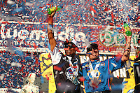 Nov 13, 2016; Pomona, CA, USA; NHRA top fuel driver Antron Brown (left) and funny car driver Ron Capps celebrate after winning the 2016 world championships following the Auto Club Finals at Auto Club Raceway at Pomona. Mandatory Credit: Mark J. Rebilas-USA TODAY Sports