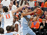 Jan. 8, 2011; Charlottesville, VA, USA; North Carolina Tar Heels guard Kendall Marshall (5) shoots in front of Virginia Cavaliers guard Sammy Zeglinski (13) during the game at the John Paul Jones Arena. North Carolina won 62-56. Mandatory Credit: Andrew Shurtleff-