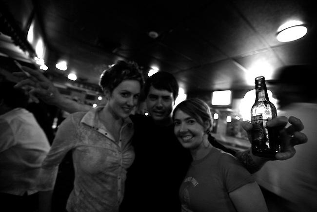 Jessica, Mike and Sarah at Grant's Lounge in Macon, Ga. May 30, 2009.