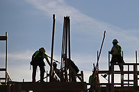 Commercial construction sites and workers