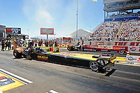 Apr. 1, 2011; Las Vegas, NV, USA: NHRA top fuel dragster driver Troy Buff (near) races alongside Ron August Jr during qualifying for the Summitracing.com Nationals at The Strip in Las Vegas. Mandatory Credit: Mark J. Rebilas-