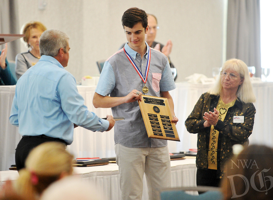 """NWA Democrat-Gazette/Michael Woods --04/22/2015--w@NWAMICHAELW... Har-Ber High School student Mason Cline smiles as he receives his award during the 29th Annual """"Good Hearts"""" Youth Excellence Awards presented by the Fayetteville Sequoyah Kiwanis Wednesday afternoon at the Hilton Garden Inn in Fayetteville."""