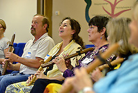 NWA Democrat-Gazette/BEN GOFF &bull; @NWABENGOFF<br /> Ken Dickerson (from left), Tracy Fortuny and other participants learn to play the Native American flute on Sunday July 12, 2015 as classical crossover duo Armand and Angelina, from Orlando, Fla., lead a native american flute 'play shop' at Unity Church of the Ozarks in Bentonville.