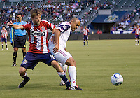 Chivas USA forward Blair Gavin (18) battles with Real Salt Lake defender Robbie Russell (3). Real Salt Lake defeated CD Chivas USA 2-1at Home Depot Center stadium in Carson, California on Saturday May 22, 2010.  .