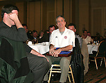 """Jon Stewart, host of Comedy Central's """"The Daily Show"""" holds the plaque declaring him to the NSCAAs Honorary All-America Team for 2005 as he listens to another speaker on Saturday, January 21st, 2006, during the National Soccer Coaches Association of America's annual convention in the Grand Ballroom of the Pennsylvania Convention Center in Philadelphia, PA."""