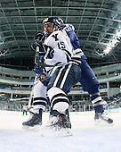 Clinton Bourbonais (Yale - 15), Tim Kirby (Air Force - 25) - The Yale University Bulldogs defeated the Air Force Academy Falcons 2-1 (OT) in their East Regional Semi-Final matchup on Friday, March 25, 2011, at Webster Bank Arena at Harbor Yard in Bridgeport, Connecticut.
