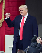 Donald J. Trump shakes his fist as he arrives to be sworn-in as the 45th President of the United States on the West Front of the US Capitol on Friday, January 20, 2017.<br /> Credit: Ron Sachs / CNP<br /> (RESTRICTION: NO New York or New Jersey Newspapers or newspapers within a 75 mile radius of New York City)