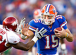 Gator quarterback Tim Tebow attemps to stiff arm Arkansas' Ramon Broadway in the 2nd half of the Gators 23-20 victory over the Razorbacks in their NCAA football game in Gainesville, Florida October 17, 2009.