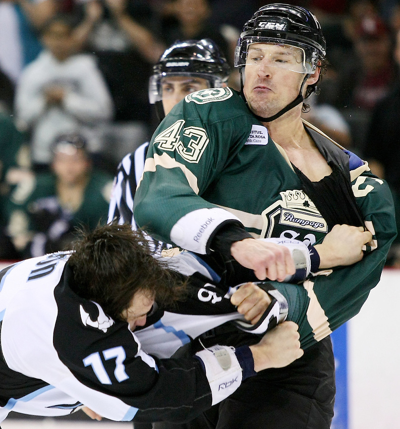 San Antonio Rampage's Nolan Yonkman, right, punches Milwaukee Admirals' Kelsey Wilson during the second period of an AHL hockey game, Friday, March 18, 2011, in San Antonio. (Darren Abate/pressphotointl.com)
