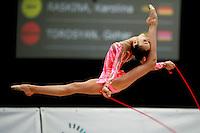 Daria Kushnerova of Ukraine split leaps with rope at 2007 Portimao World Cup of Rhythmic Gymnastics on April 26, 2006.  (Photo by Tom Theobald)..