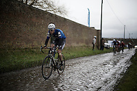 (eventual winner) Niki Terpstra (NLD/Etixx-QuickStep) creating a distance between him and his rivals on the wet cobbles of the Rue Belle Vue<br />