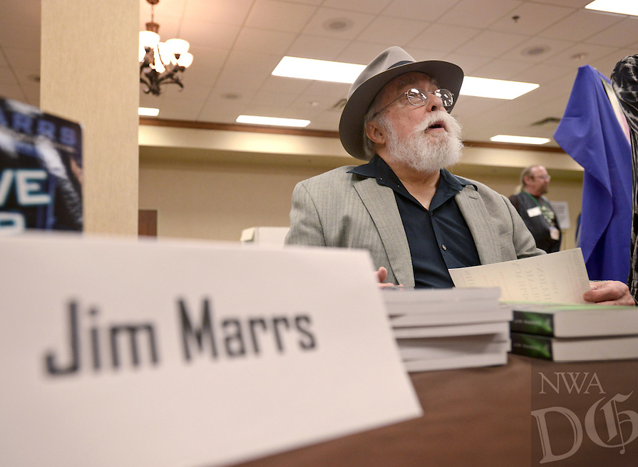 NWA Democrat-Gazette/BEN GOFF @NWABENGOFF<br /> Jim Marrs, an author and speaker from Texas, talks to guests at his table on Saturday April 9, 2016 during the 29th annual Ozark Mountain UFO Conference at the Best Western Inn of the Ozarks in Eureka Springs. Marrs' books cover a wide variety of topics including unidentified flying objects, World War II and the assassination of President Kennedy.