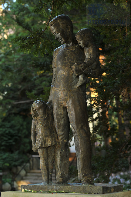 Tom Dooley statue near the Grotto..Photo by Matt Cashore/University of Notre Dame