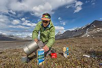 Cooking a Mountain House dehydrated meal dinner. Arctic National Wildlife Refuge, Brooks Range, Arctic Alaska.