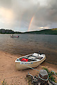 ID00542-00...IDAHO - Doug Anderson fishing in Stanley Lake during a rain shower with a rainbow, Stanley Lake National Recreation Area.  (MR# A7)