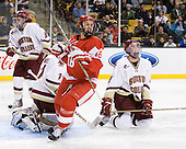 Edwin Shea (BC - 8), John Muse (BC - 1), Wade Megan (BU - 18), Brian Dumoulin (BC - 2) - The Boston College Eagles defeated the Boston University Terriers 3-2 (OT) in their Beanpot opener on Monday, February 7, 2011, at TD Garden in Boston, Massachusetts.