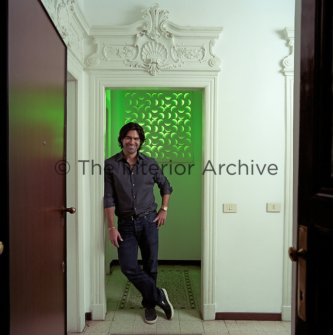 Brian Atwood in the entrance to his 1920s Milan apartment