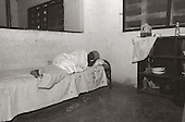 A woman who has tuberculosis rests inside a hut at the tuberculosis clinic on the Albert Schweitzer hospital compound. photo by jane therese