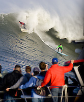 Evan Slater (red) exits as Grant 'Twiggy' Baker (grn) completes the drop during the 2009/2010 Sony Ericsson/Barracuda Networks, Mavericks Surf Contest on Saturday February 13, 2010...