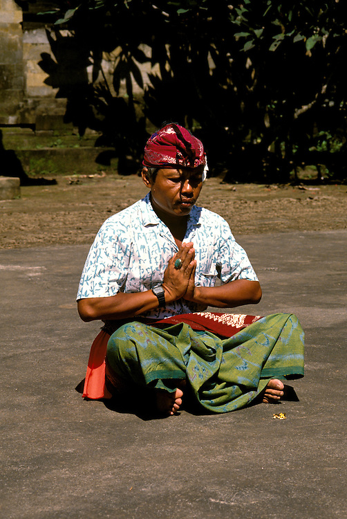 Worshipper, Pura Desa, Bali, Indonesia, Asia, photo bali214, Photo Copyright:  Lee Foster, www.fostertravel.com, 510-549-2202, lee@fostertravel.com, worshipper, worship, prayer, meditate, religion, religious, praying, prayerful, verticlal