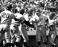 KILLEBREW GRAND SLAM:Harmon Killebrew is greeted<br />at home by teammates Rich Reese, Tony Oliva, Ted Ulander, and Cesar Tovar. (1969 photo by Ron Riesterer)