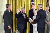 United States Secretary of State Colin Powell swears-in former U.S. Senator Howard Baker (Republican of Tennessee) as U.S. Ambassador to Japan during a ceremony in the East Room at the White House in Washington, D.C. on June 26, 2001.  U.S. President George W. Bush looks on from left.  Baker's wife, former U.S. Senator Nancy Landon Kassebaum (Republican of Kansas) holds the bible.  Former U.S. Vice President Walter Mondale looks on from far right..Credit: Ron Sachs / CNP
