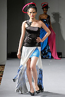 Tuyt Lan, Vietnam's Next Top Model 2010 walks the runway in an outfit from Sushma Patel Fall 2012 collection, during Couture Fashion Week New York, February 17, 2012.