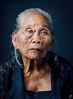 "Wagiyem (born 1929) was one of tens of thousands of 'comfort women' forced into prostitution by the Japanese military during World War II..Wagiyem was taken from her village and forced for three months into prostitution at a barracks. Every day she had to apply make-up with powder and lipstick, just like the other women. At night, soldiers took her to their rooms in the barracks complex. ""I was grabbed and kissed and such. I was afraid they would kill me but also that I would get pregnant."" She didn't dare try to escape; the barracks were under surveillance. When she gained freedom at the end of the war, it turned out that her younger sister Semi (also portrayed in this series) and an older sister, too, had been sexually abused by soldiers. ""I've always warned my daughters to be careful and not to go along with strangers, because otherwise they would get raped, just like me."""