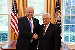 US President Donald Trump shakes hands with Palestinian President Mahmoud Abbas during a meeting in the Oval Office of the White House on May 3, 2017 in Washington, DC. Photo by Thaer Ganaim