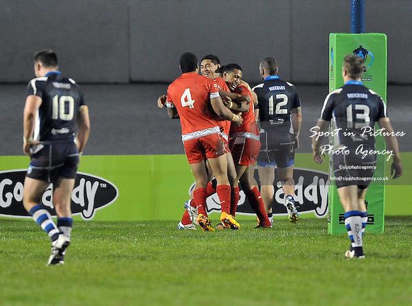 tryscorer Willie Manu (Tonga) celebrates with Jorge Taufua (Tonga, 4)   - PHOTO: Mandatory by-line: Garry Bowden/SIPPA/Pinnacle - Photo Agency UK Tel: +44(0)1363 881025 - Mobile:0797 1270 681 - VAT Reg No: 768 6958 48 - 29/10/2013 - Rugby League World Cup 2013, Tonga v Scotland, Derwent Park, Workington, Cumbria, England