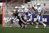 Mike Manley (37) of Duke tries to stop the shot of Matt Miller (37) of Notre Dame during the NCAA Men's Lacrosse Championship held at M&T Stadium in Baltimore, MD.  Duke defeated Notre Dame, 6-5, to win the title in overtime.