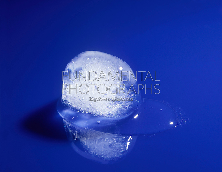 ICE CUBE MELTING<br /> Melting Ice Cube Shows Two States of Matter<br /> Water frozen into cube shape begins to melt at room temperature, returning to its liquid state.