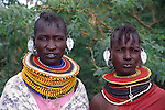Africa. Kenya. Lake Turkana.Turkana women dressed in traditional jewerly and clothing....