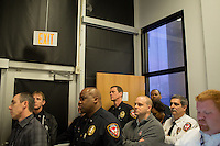 Durham Police Chief Lopez (bottom second to right)watches from the back of the room as his administration reads a prepared summary and narrative of the department's investigation into the alleged suicide of Jesus Huerta, 17, while in police custody on November 19, 2013 at police headquarters in Durham, N.C. on Friday, January 10, 2014. (Justin Cook)