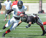 Jodi Miller Lubbock Avalanche-Journal.Texas Tech wide receiver Edward Britton, 27, makes corner back Marcus Bunton, 1, during the Red Raiders scrimmage Saturday afternoon at Jones Stadium.