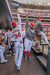 7 October 2016: Washington Nationals outfielder Bryce Harper gets a high five from pitcher Tanner Roark prior to the first game of the NLDS against the Los Angeles Dodgers at Nationals Park in Washington, DC. The Dodgers edged out the Nationals 4-3 to take the opening game of their best-of-five series. Mandatory Credit: Ed Wolfstein Photo *** RAW (NEF) Image File Available ***