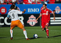 01 July 2010:  Houston Dynamo midfielder Brian Mullan #9 and Toronto FC midfielder Nick LaBrocca #21 in action during a game between the Houston Dynamo and the Toronto FC at BMO Field in Toronto..Final score was 1-1....