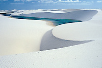 Lencois Maranhenses Natinoal Park in  Maranhão State, northeastern Brazil. Composed of large, white, sweeping dunes, at first glance Lençóis Maranhenses looks like an archetypal desert. In fact it isn't actually a desert. Between January and July the dune fields are flooded by a near infinite number of cold and crystal lakes. During these months it rains constantly and the soils become saturated and standing water accumulates on the surface, forming ponds up to 100 meters ( 300 feet ) wide, which merge with the perennial streams and lakes that dot the landscape.