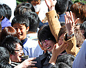 March 10, 2011, Tokyo, Japan - A test-taker is congratulated with banzai cheers on his passing the second phase of Tokyo UniversityÅfs entrance examinations as the results are posted on the Hongo campus in Tokyo on Thursday, March 10, 2011. A total of 3009 applicants passed the exams to be enrolled by the nationÅfs most prestigious institution. (Photo by Natsuki Sakai/AFLO) [3615] -mis-