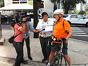 Japanese journalists ask a Tampa resident which candidate's economic policies he prefers.