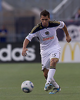 Philadelphia Union defender Gabriel Farfan (15) passes the ball. In a Major League Soccer (MLS) match, the Philadelphia Union defeated the New England Revolution, 3-0, at Gillette Stadium on July 17, 2011.