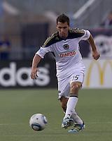 Philadelphia Union defender Gabriel Farfan (15) passes the ball. In a Major League Soccer (MLS) match, the Philadelphia Union defeated the New England Revolution, 3-0, at Gillette Stadium on July 17, 2011.