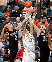 Dec. 22, 2010; Charlottesville, VA, USA; Seattle Redhawks and Seattle Redhawks forward Chad Rasmussen (15) go after the rebound with Virginia Cavaliers guard Joe Harris (12) during the game at the John Paul Jones Arena. Seattle Redhawks won 59-53. Mandatory Credit: Andrew Shurtleff
