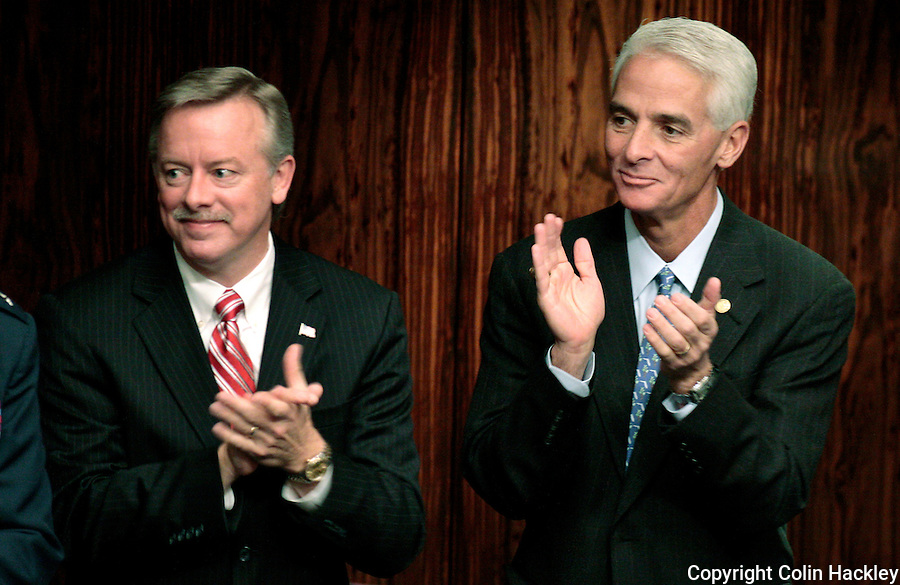 TALLAHASSEE, FL. 3/3/09-Lt. Gov. Jeff Kottkamp, left, and Gov. Charlie Crist, applaud during opening day ceremonies in the Florida Senate, March, 3, 2009 at the Capitol in Tallahassee...COLIN HACKLEY PHOTO
