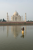 Sadhu in the river in front of The Taj Mahal.