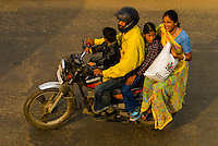 A family riding on a motorcycle near Choti Chaupar (circle) in Jaipur, Rajasthan, India